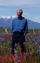 Herman I Neuman in field of Camas flowers near Idaho's Sawtooth Mountains.